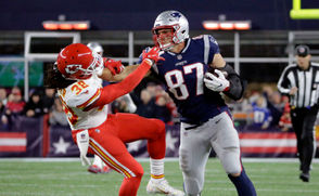 New England Patriots tight end Rob Gronkowski (87) gives a stiff arm to Kansas City Chiefs free safety Ron Parker (38) after catching a pass during the second half of an NFL football game, Sunday, Oct. 14, 2018, in Foxborough, Mass.